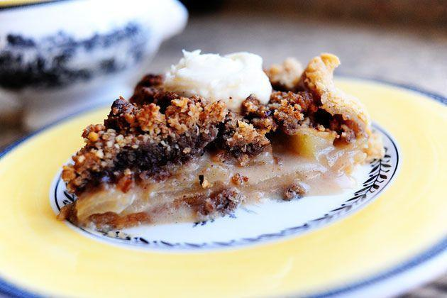 """<p>Rich and crumbly, this recipe is known as Ree's """"Dreamy Apple Pie"""" for a reason. It's combined with all of the autumnal flavors we love, including vanilla, cinnamon, brown sugar, and pecans.</p><p><strong><a href=""""https://www.thepioneerwoman.com/food-cooking/recipes/a9553/dreamy-apple-pie/"""" rel=""""nofollow noopener"""" target=""""_blank"""" data-ylk=""""slk:Get the recipe."""" class=""""link rapid-noclick-resp"""">Get the recipe.</a></strong></p>"""