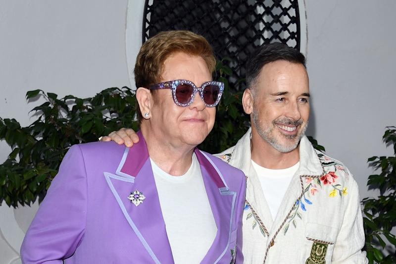 "ANTIBES, FRANCE - JULY 24: Sir Elton John and David Furnish attend the first ""Midsummer Party"" hosted by Elton John and David Furnish to raise funds for the Elton John Aids Foundation on July 24, 2019 in Antibes, France. (Photo by Daniele Venturelli/Daniele Venturelli/Getty Images )"