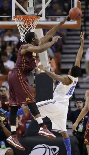 Minnesota's Trevor Mbakwe, left, goes up to block the shot of UCLA's Larry Drew II (10) during the first half of a second-round game of the NCAA men's college basketball tournament Friday, March 22, 2013, in Austin, Texas. (AP Photo/David J. Phillip)