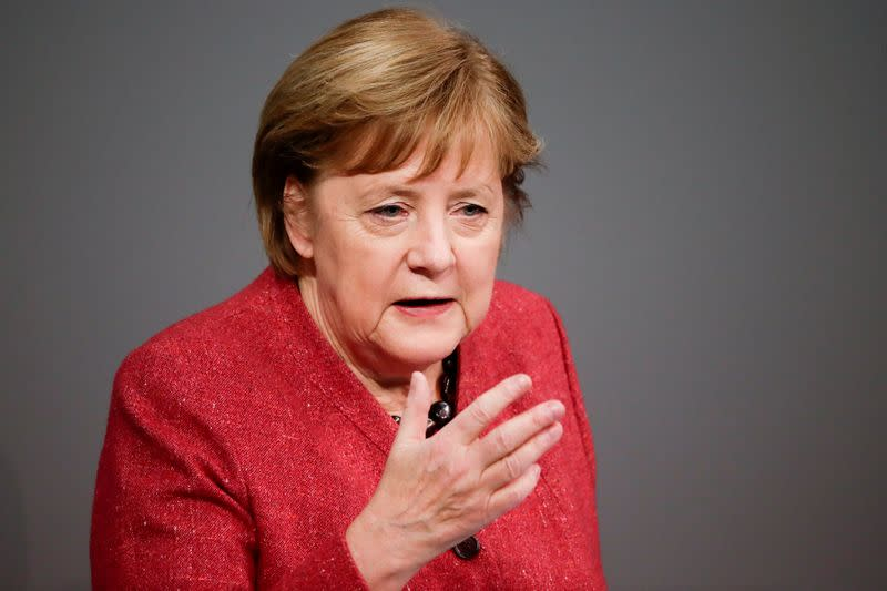 FILE PHOTO: German Chancellor Angela Merkel delivers a speech in parliament, in Berlin