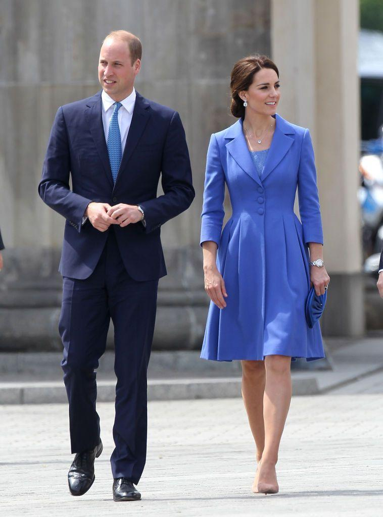 <p>Duchess Kate tours Berlin in a custom cornflower blue Catherine Walker coat paired with her favorite nude pumps.</p>