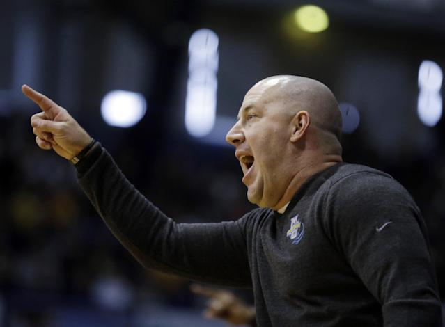 Marquette head coach Buzz Williams calls a play for his team as they played Butler in the first half of an NCAA college basketball game in Indianapolis, Saturday, Jan. 18, 2014. (AP Photo/Michael Conroy)