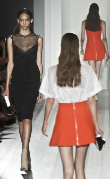 Fashion from the Spring 2013 collection of Victoria Beckham is modeled on Sunday, Sept. 9, 2012 in New York. (AP Photo/Bebeto Matthews)