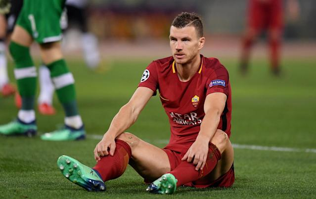 Soccer Football - Champions League Semi Final Second Leg - AS Roma v Liverpool - Stadio Olimpico, Rome, Italy - May 2, 2018 Roma's Edin Dzeko reacts after a challenge in the penalty area REUTERS/Alberto Lingria