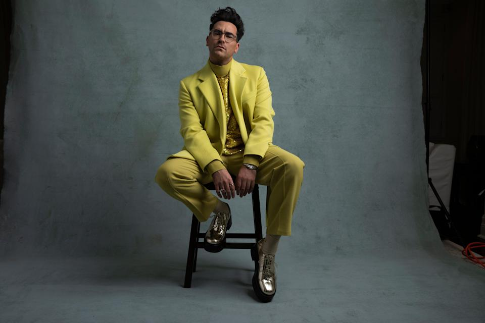 """<h2>Dan Levy in Valentino</h2><br>Dan Levy, a favorite on the red carpet, chose a chartreuse Valentino suit to begin the last award show season of the <em>Schitt's Creek</em> era.<span class=""""copyright"""">Photo Credit: Lewis Mirrett.</span>"""