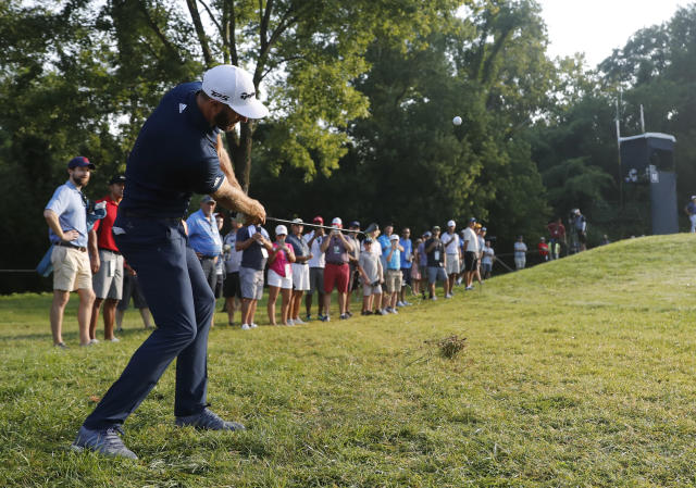 Dustin Johnson braved a wayward tee shot to card a birdie at the PGA Championship. (AP)