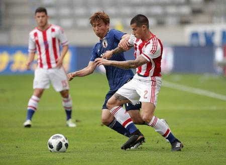 Soccer Football - International Friendly - Japan vs Paraguay - Tivoli-Neu, Innsbruck, Austria - June 12, 2018 Japan's Takashi Inui in action with Paraguay's Alan Max Benitez REUTERS/Lisi Niesner