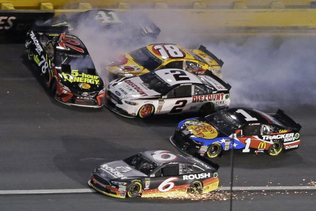Martin Truex Jr. (78), Kurt Busch (41), Kyle Busch (18) and Brad Keselowski (2) wreck in Turn 4 as Jamie McMurray (1) and Matt Kenseth (6) try to get by during the NASCAR All-Star auto race at Charlotte Motor Speedway in Concord, N.C., Saturday, May 19, 2018. (AP Photo/Terry Renna)