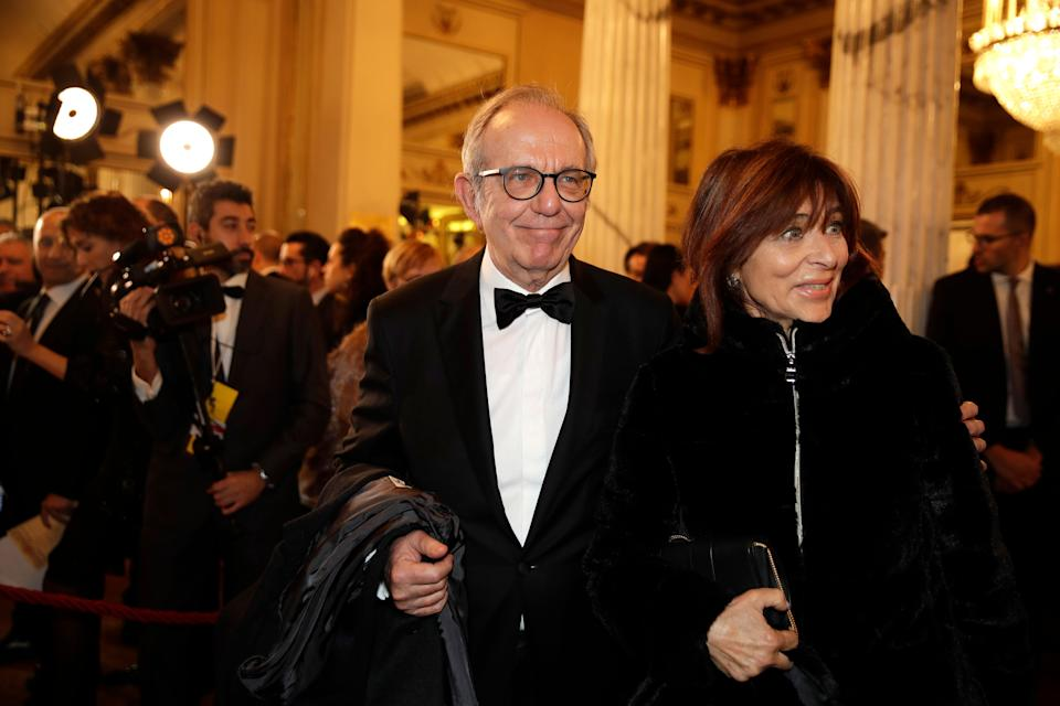 """Pier Carlo Padoan is flanked by his wife Maria Grazia arrive for the gala premiere of La Scala opera house, in Milan, Italy, Saturday, Dec. 7, 2019. Milan's storied La Scala opens its 2019-2020 season on Saturday with Puccini's """"Tosca,"""" which stars Russian soprano Anna Netrebko as the object of unwanted sexual attention from a powerful authority figure. (AP Photo/Luca Bruno) (Photo: ASSOCIATED PRESS)"""