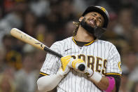 San Diego Padres' Fernando Tatis Jr. reacts as he strikes out while batting during the ninth inning of a baseball game against the San Francisco Giants, Tuesday, Sept. 21, 2021, in San Diego. (AP Photo/Gregory Bull)