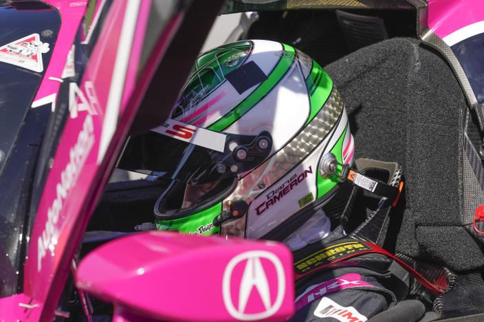 Dane Cameron prepares to go out on the track for a turn driving during a practice session for the Rolex 24 hour race at Daytona International Speedway, Friday, Jan. 29, 2021, in Daytona Beach, Fla. (AP Photo/John Raoux)