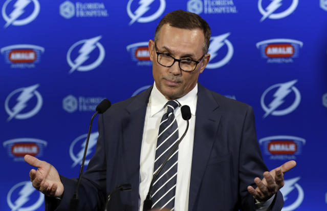 FILE - In this Feb. 26, 2018, file photo, Tampa Bay Lightning general manager Steve Yzerman gestures during a news conference before an NHL hockey game against the Toronto Maple Leafs, in Tampa, Fla. A person with knowledge of the move says Steve Yzerman is stepping down as general manager of the Tampa Bay Lightning and will be replaced immediately by assistant Julien BriseBois. The person spoke to The Associated Press on condition of anonymity Tuesday, Sept. 11, 2018, because the team had not announced Yzerman's decision. (AP Photo/Chris O'Meara, File)