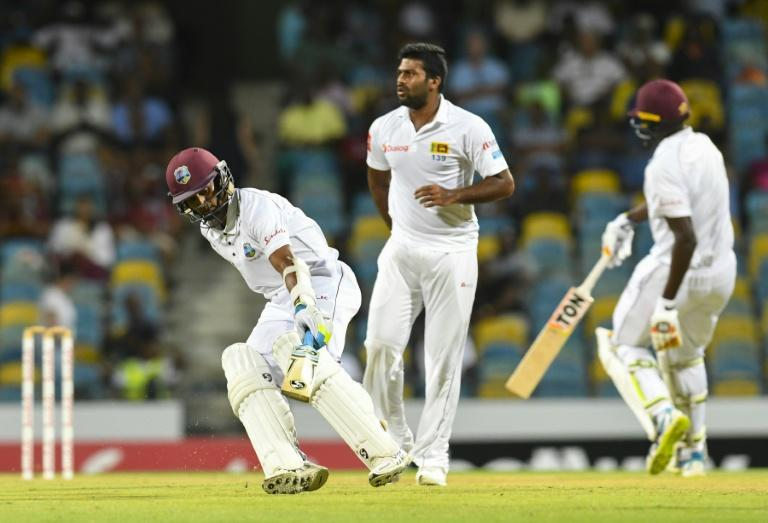 Kasun Rajitha (L) of Sri Lanka celebrates the dismissal of Shai Hope of West Indies on Day 1 of their 3rd Test match, at Kensington Oval in Bridgetown, Barbados, on June 23, 2018