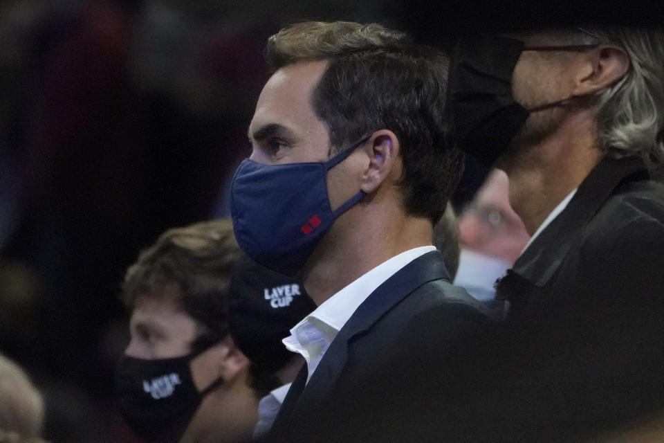 Tennis great Roger Federer watches the Laver Cup presentation from court side after Team Europe defeated Team World in Laver Cup tennis, Sunday, Sept. 26, 2021, in Boston. (AP Photo/Elise Amendola)