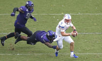 SMU quarterback Shane Buechele (7) runs the ball as TCU defensive tackle Corey Bethley (94) and defensive tackle Ross Blacklock (90) pursue during the first half of an NCAA college football game Saturday, Sept. 21, 2019, in Fort Worth, Texas. (AP Photo/Ron Jenkins)