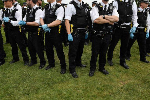 PHOTO: Police officers are seen policing an anti-lockdown demonstration in Hyde Park in London, United Kingdom, on May 16, 2020, following an easing of restrictions in England amid the coronavirus pandemic. (Justin Tallis/AFP via Getty Images)