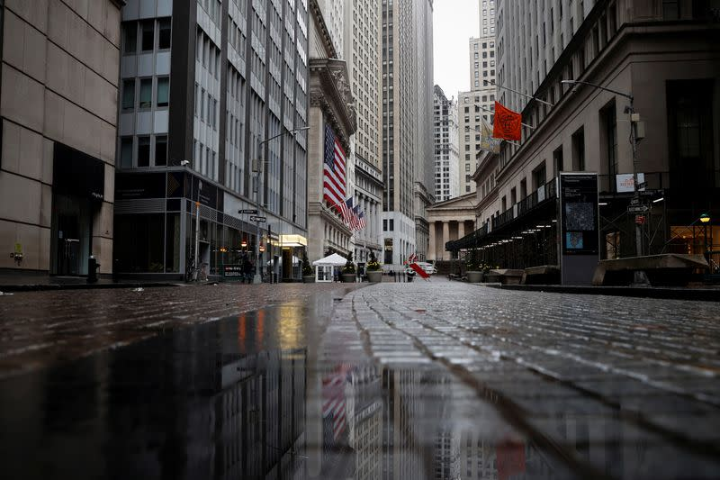A view of a nearly deserted Broad street and and the New York Stock Exchange in the financial district of lower Manhattan in New York