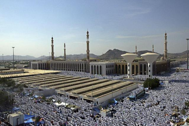 <b>ARAFAT, SAUDI ARABIA: </b>Muslim pilgrims attend noon prayers at the Nimira mosque in Arafat, outside the holy city of Mecca in Saudi Arabia. Muslim pilgrims journey to Arafat, a revered place in Islam, for the culmination of the Hajj rituals. Mount Arafat, about 70 metres high, is a granite hill to the east of the Holy City of Makkah. The pious believe that it was on Mount Arafat that Adam and Eve, separated for 200 years, recognized each other and were reunited.
