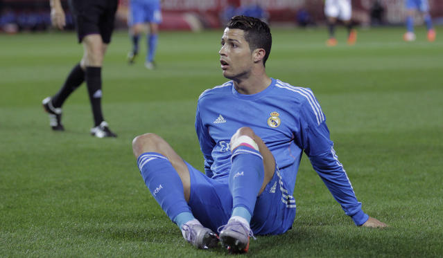 Real Madrid's Cristiano Ronaldo from Portugal reacts during a La Liga soccer match against Sevilla at the Ramon Sanchez Pizjuan stadium, in Seville, Spain on Wednesday, March 26, 2014. (AP Photo/Angel Fernandez)