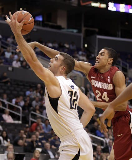 California's Harper Kamp, left, gets a rebound against Stanford's Josh Huestis during the first half of an NCAA college basketball game at the Pac-12 conference championship in Los Angeles, Thursday, March 8, 2012. (AP Photo/Jae C. Hong)
