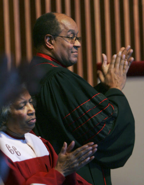 FILE - In this Feb. 4, 2007, file photo, The Rev. William H. Gray III applauds on stage at the Bright Hope Baptist Church during services in Philadelphia. Gray, who rose to influential positions in Congress while remaining pastor of his north Philadelphia church for 3½ decades, has died, a family spokesman said Monday, July 1, 2013. He was 71. (AP Photo/Rusty Kennedy, File)