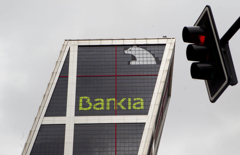 FILE - In this Monday May 7, 2012 file photo, the Bankia bank headquarters is seen in Madrid. Spain's market regulator suspended trading of shares in bailed-out Bankia on Friday May 25, 2012, ahead of a key board meeting at which the lender is expected to decide how much more rescue money it needs from the government. (AP Photo/Paul White, file)