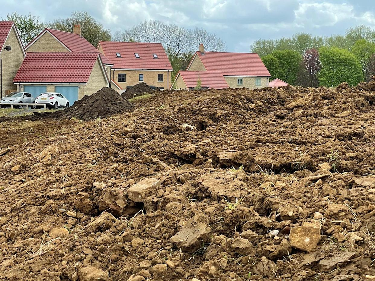 """Residents in Corsham, Wiltshire, say the """"mountain"""" caused flooding in their gardens. (SWNS)"""