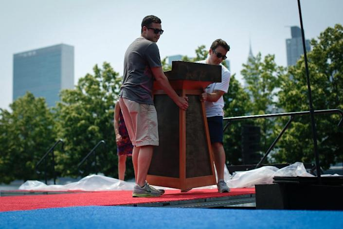 Workers install the stage as they prepare for Hillary Clinton's presidential campaign launch on Roosevelt Island in New York (AFP Photo/Kena Betancur)