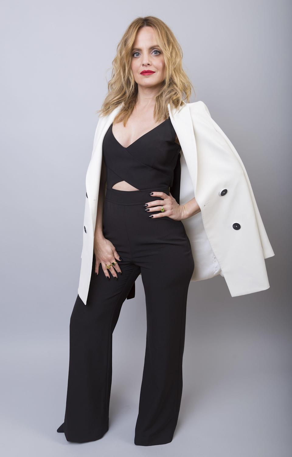 """Mena Suvari, a castmember in the Paramount Network series """"American Woman,"""" poses for a portrait during the 2018 Television Critics Association Winter Press Tour at the Langham Hotel on Monday, Jan. 15, 2018, in Pasadena, Calif."""