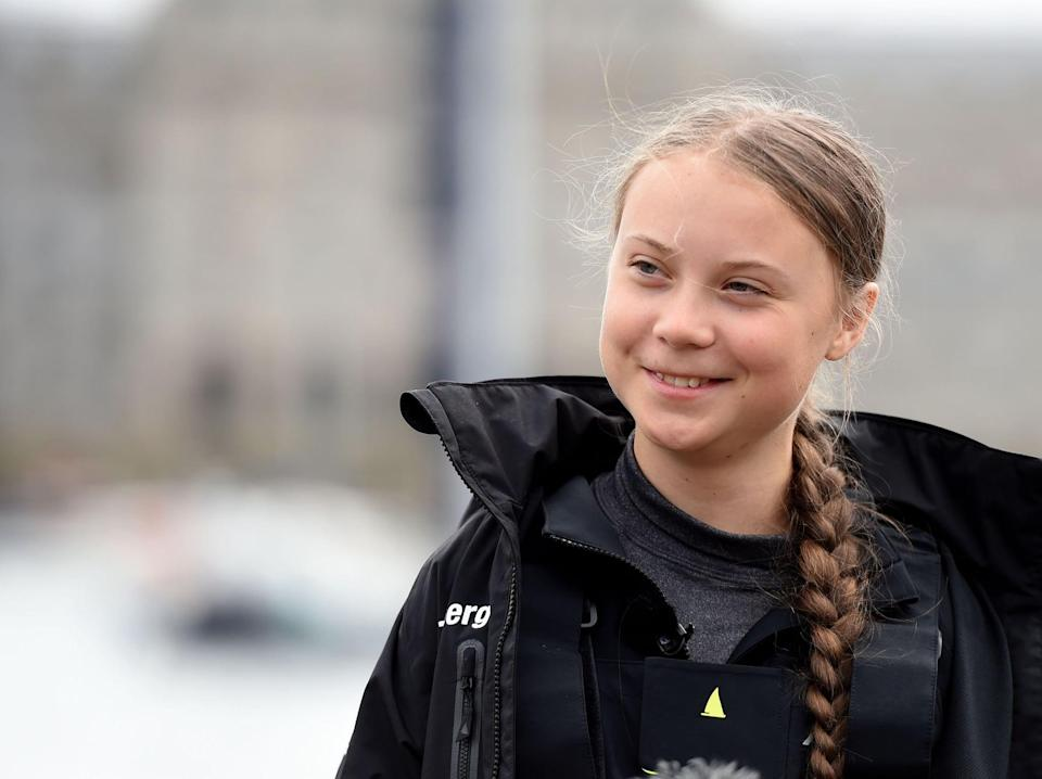 PLYMOUTH, ENGLAND - AUGUST 14: Climate change activist Greta Thunberg speaks at a press conference before setting sail for New York in the 60ft Malizia II yacht from Mayflower Marina, on August 14, 2019 in Plymouth, England. Greta Thunberg is a teenage activist born in Sweden in 2003. She began protesting outside the Belgian Parliament aged 15 and started the School Strike for Climate movement which has gained global popularity seeing school students campaigning against Climate Change on Fridays instead of attending their lessons. Greta has stopped flying as the aviation industry is responsible for 12% of CO2 emissions from all forms of  transports. Once in New York she will attend a climate change conference. (Photo by Finnbarr Webster/Getty Images)