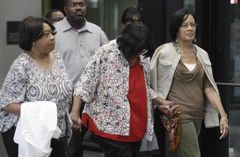 Supporters of Jennifer Hudson leave the criminal courts building after a Cook County judge convicted William Balfour to three life sentences plus 120 years for the murders of the mother, brother and nephew of Grammy and Oscar award winner Jennifer Hudson, Tuesday, July 24, 2012, in Chicago. The sentencing came after Circuit Judge Charles Burns denied a request from Balfour for a new trial. Balfour faced a mandatory life sentence. Illinois does not have the death penalty. (AP Photo/M. Spencer Green)