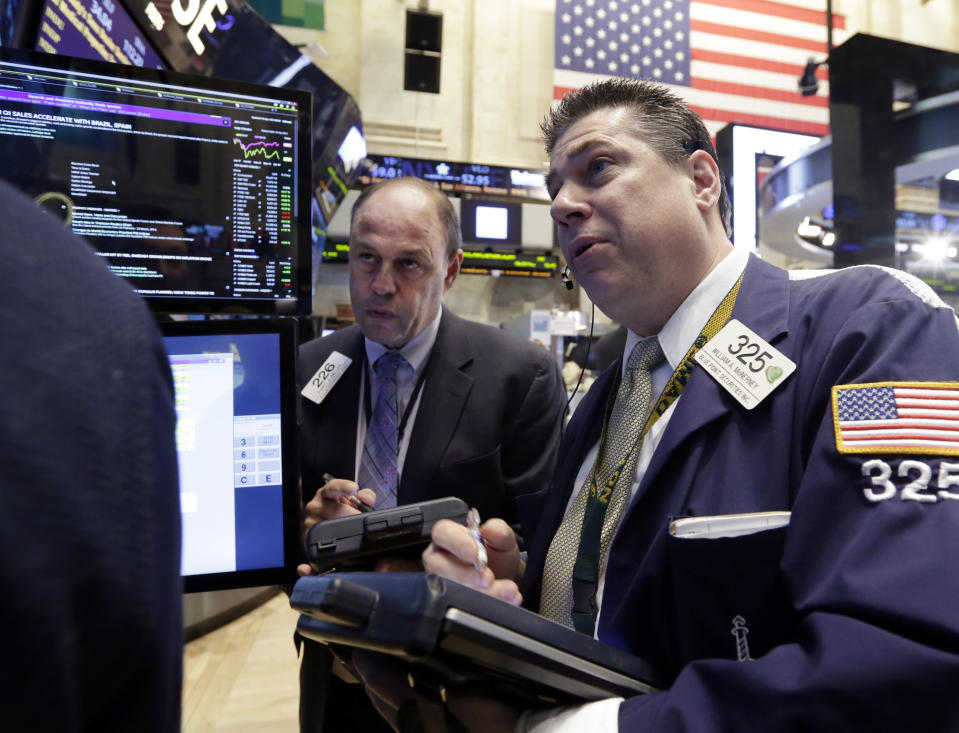 <p> Traders Randy Beller, left, and William McInerney work on the floor of the New York Stock Exchange Thursday, April 10, 2014. U.S. stock indexes are slipping lower in early trading Thursday as investors pick over a mixed batch of corporate earnings reports. (AP Photo/Richard Drew)</p>