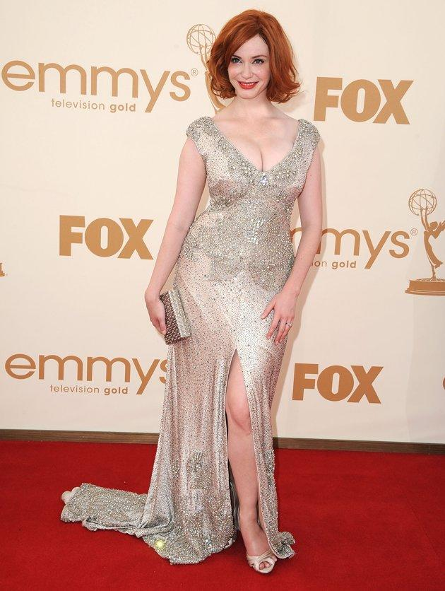 """Red-headed bombshell Christina Hendricks has gained as much attention for her voluptuous curves as her winning performance on """"Mad Men"""". But despite the (often negative) chatter, Hendricks has always embraced her sexy figure - """"Sure, I'd be happier with 10 pounds off—wouldn't every woman? But at the same time, when I looked at myself [at the Emmys], I thought I looked beautiful. I didn't tear myself apart."""""""