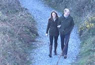 <p>Kate Middleton links her arms in Prince William's as they take a walk to Howth Cliff during their trip to Dublin, Ireland. </p>