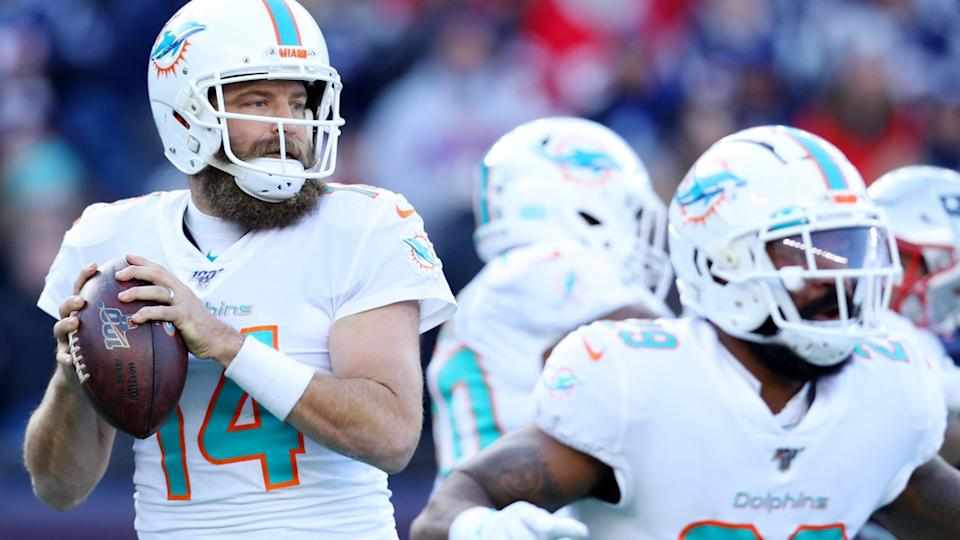 FOXBOROUGH, MASSACHUSETTS - DECEMBER 29: Ryan Fitzpatrick #14 of the Miami Dolphins looks to pass duirng the game against the New England Patriots  at Gillette Stadium on December 29, 2019 in Foxborough, Massachusetts.