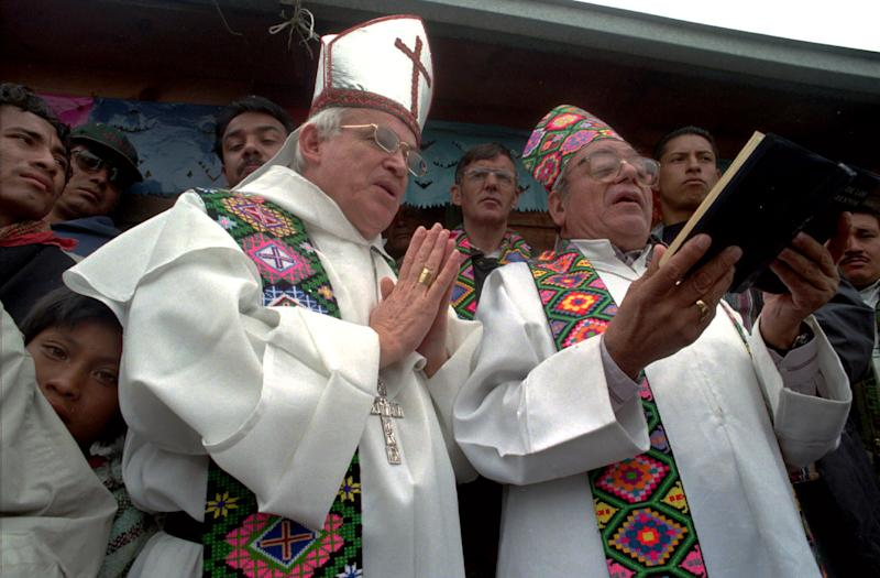 FILE - In this March 10, 1998 file photo, Bishop of San Cristobal de las Casas, Samuel Ruiz, right, and auxiliary Bishop Raul Vera give a blessing at the Tzeltal Indian community of Chanal in the Chiapas highlands of Mexico. Vera arrived in Saltillo as Bishop in 2000, with a reputation as a social crusader. Marked by his unvarnished speech, Vera's voice now carries beyond his diocese here, especially when he weighs in on issues such as drug violence, vulnerable immigrants and gay rights. (AP Photo/Pasqual Gorriz, File)