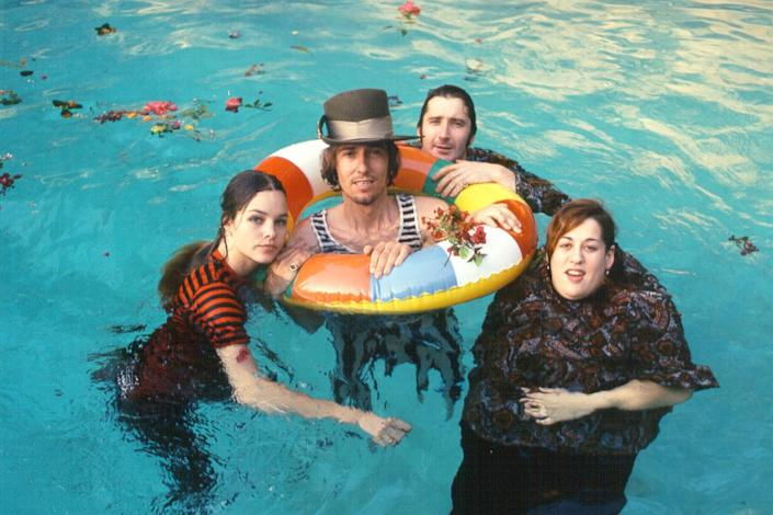 The Mamas and the Papas float in a pool for a publicity shot.