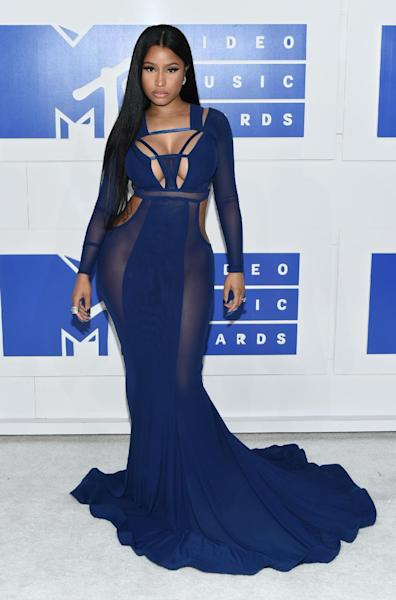 """FILe - In this Aug. 28, 2016 file photo, Nicki Minaj arrives at the MTV Video Music Awards in New York Minaj, Beyonce and Alicia Keys, artist-owners of Tidal, will perform at a concert in New York for the streaming service. The Oct. 15 event, dubbed """"TIDAL X: 1015"""" will be held at the Barclays Center in Brooklyn. (Photo by Evan Agostini/Invision/AP, File)"""