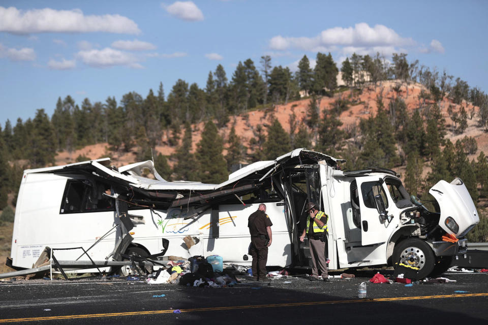 FILE - Authorities work the scene of a tour bus crash near Bryce Canyon National Park on Sept. 20, 2019, in Utah. The tour bus that crashed and killed four Chinese tourists near a national park in Utah in 2019 had problems earlier that day with the engine not starting, according to a new documents released Wednesday, March 31, 2021, by U.S. authorities investigating the incident. (Spenser Heaps/The Deseret News via AP)
