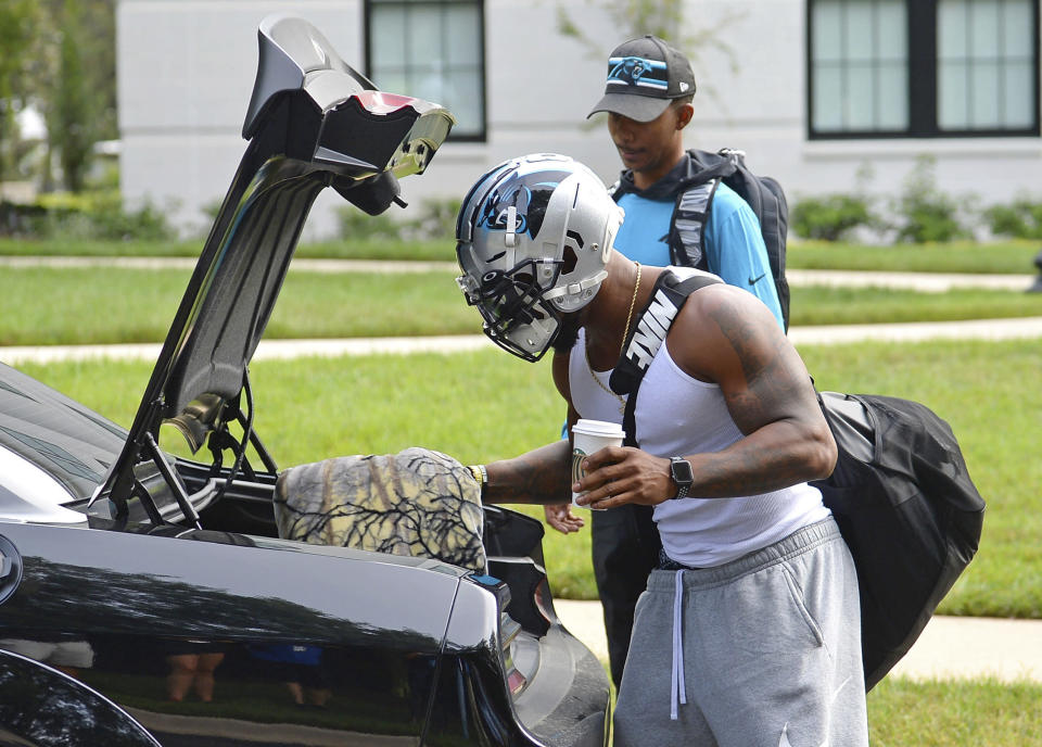 Carolina Panthers linebacker Denzel Perryman wears his football helmet as he unpacks at NFL football training camp, Tuesday, July 27, 2021, at Wofford College in Spartanburg, S.C. (Jeff Siner/The Charlotte Observer via AP)