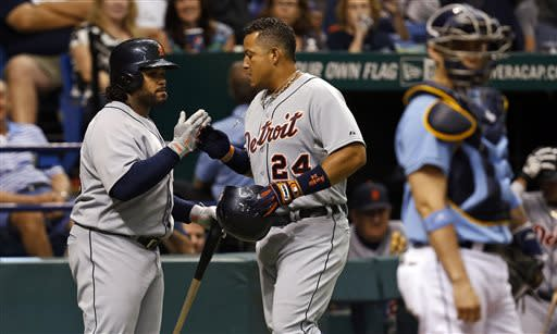 Detroit Tigers' Miguel Cabrera, center, is congratulated by teammate Prince Fielder behind Tampa Bay Rays catcher Jose Lobaton after his solo home run during the fourth inning of a baseball game Sunday, June 30, 2013, in St. Petersburg, Fla. (AP Photo/Mike Carlson)