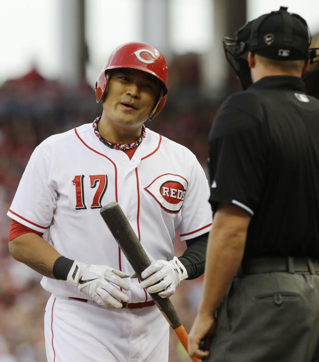 Cincinnati Reds' Shin-Soo Choo complains to home plate umpire Will Little after Choo struck out against St. Louis Cardinals starting pitcher Jake Westbrook in the first inning of a baseball game, Saturday, Aug. 3, 2013, in Cincinnati. (AP Photo/Al Behrman)