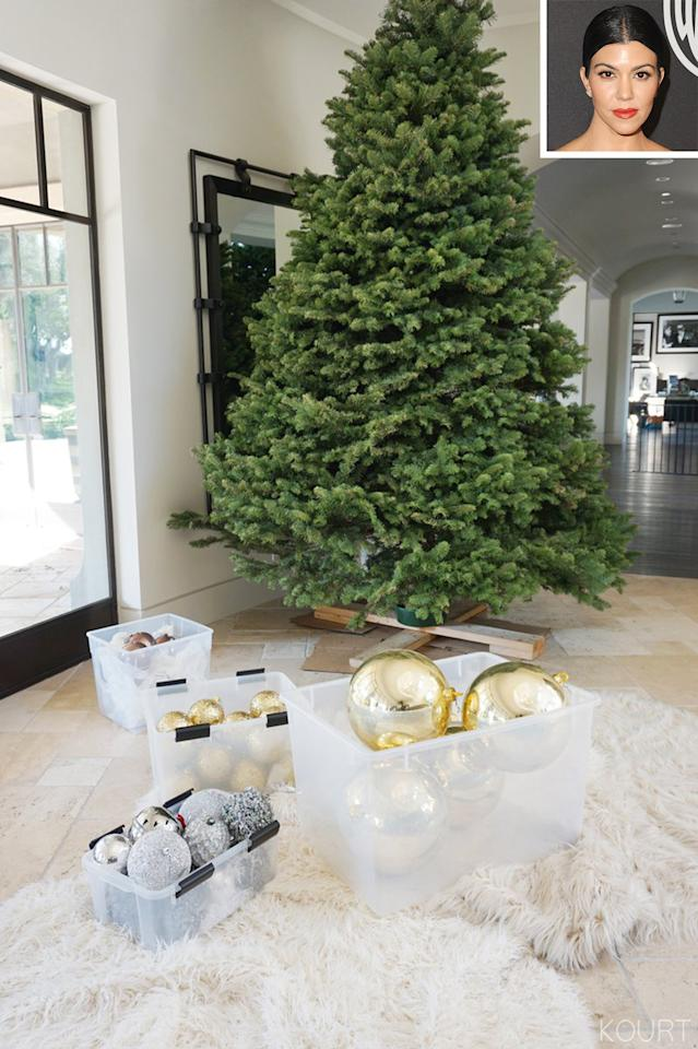 "<p>Kourtney's <a rel=""nofollow"" href=""http://people.com/home/kourtney-kardashian-christmas-decorations-house-photos/"">real Christmas secret weapon is surprisingly inexpensive</a>, but she still amped it up in 2017 with giant gold ornaments and trees in each of her three kids' rooms, as well as her own.</p>"
