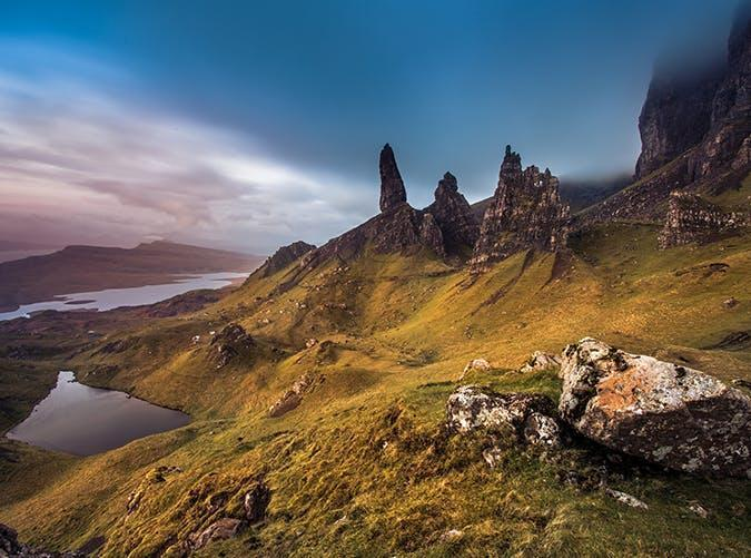 <p>Isle of Skye, an island just off Scotland's northwest coast, is pretty much a dream world. But no landscape is more iconic here than the Storr cliffs, a series of rocky pinnacles set before a backdrop of rolling green hills and coastline.</p>
