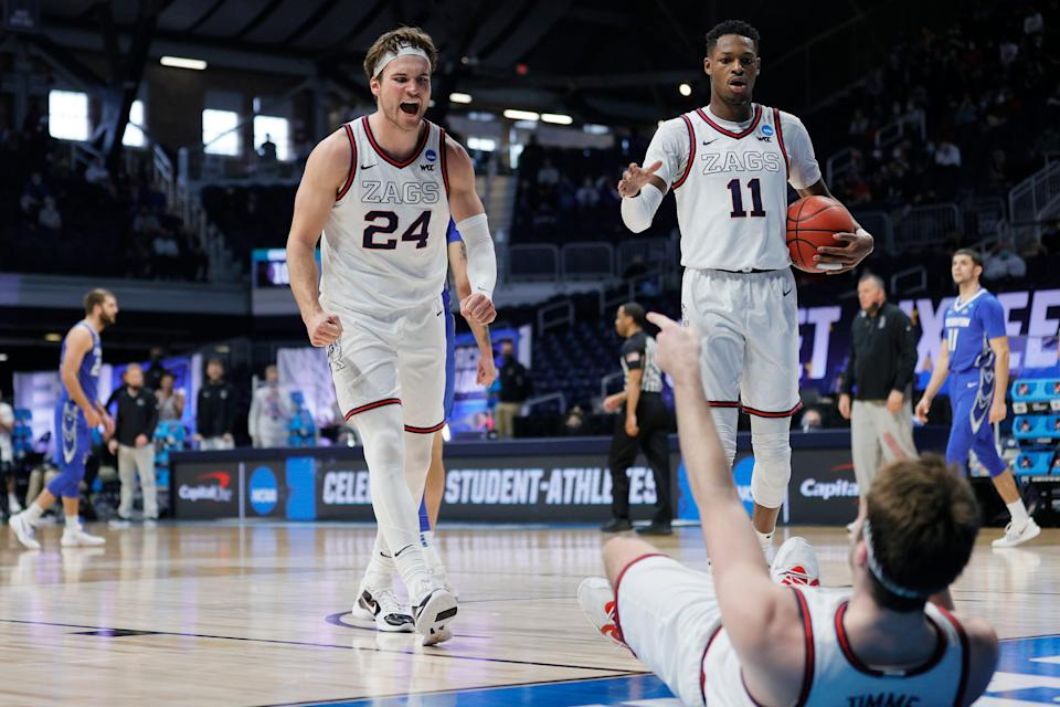 Drew Timme of Gonzaga celebrates with Corey Kispert and Joel Ayayi against Creighton during the second half of their Sweet Sixteen game of the 2021 NCAA men's tournament at Hinkle Fieldhouse.