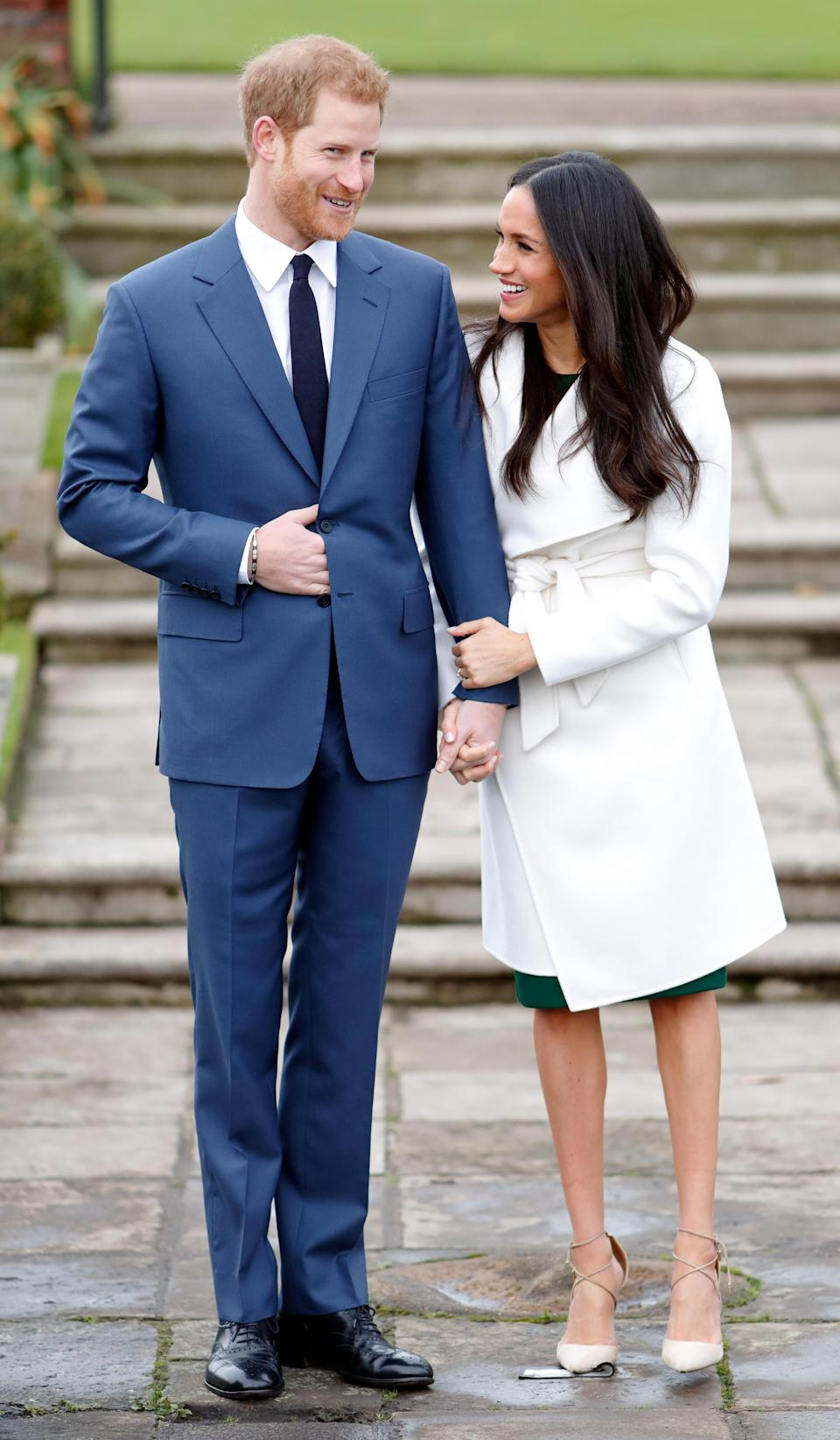 <p>The crisp, white tie-waist coat that Markle wore during her engagement photos was a nod to her time spent in Toronto while working on 'Suits'. The knee-length design was from Canadian label Line The Label. [Photo: Getty] </p>