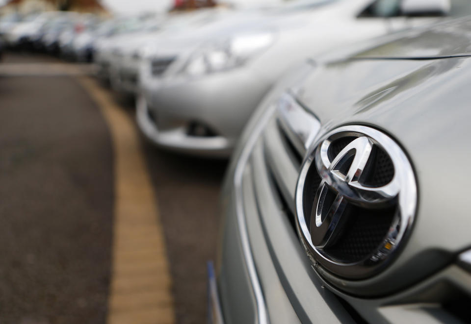 Toyota cars are lined up for sale on the forecourt of a Toyota dealer in Purley, south London, October 10, 2012. Toyota Motor Corp said it would recall more than 7.4 million vehicles worldwide as a faulty power window switch was a potential fire hazard, the latest in a series of setbacks that have dented the reputation of Japan's biggest automaker.  REUTERS/Andrew Winning (BRITAIN - Tags: TRANSPORT BUSINESS)