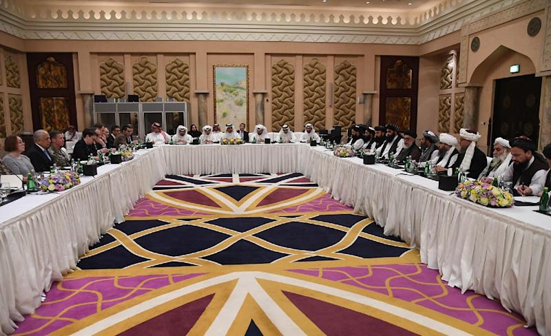 US officials led by envoy Zalmay Khalilzad meet with the Taliban and Qatari officials in Doha in February 2019 (AFP Photo/STRINGER)