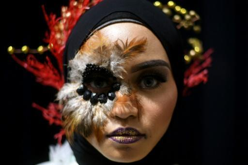 Make-up artists showcase peacock beauty in Malaysia