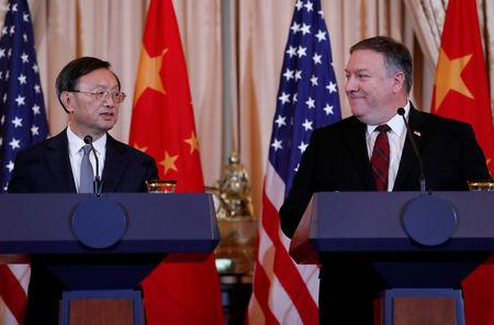 U.S. Secretary of State Mike Pompeo listens to Chinese Communist Party Office of Foreign Affairs Director Yang Jiechi speak as the two countries hold a joint news conference after participating in a second diplomatic and security meeting at the U.S. Department of State, Washington, U.S., November 9, 2018. REUTERS/Leah Millis